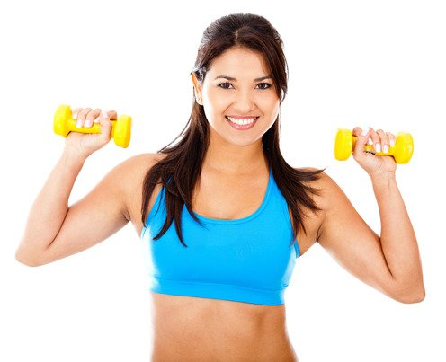 Athetic woman lifting freeweights - isolated over a white background